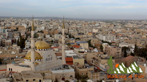 A view overlooking the city of Madaba with a large, prominent mosque towering over the rest of the city