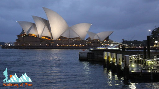Sydney Opera House lit up with lights at dusk
